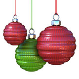 Red and green striped, hanging Christmas balls. isolated on whit