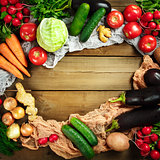 Square composition with fresh vegetables on wooden