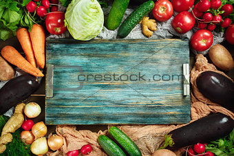 Frame made from fresh vegetables on wooden