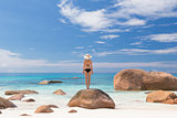 Woman enjoying Anse Lazio picture perfect beach on Praslin Island, Seychelles.
