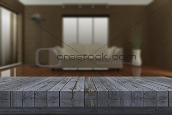 3D rustic wooden table with defocussed lounge in background