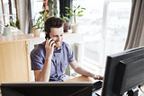 happy creative male worker calling on smarphone