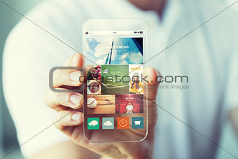 close up of male hand with news on smartphone