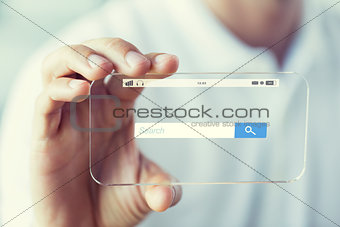 close up of hand with search bar on smartphone