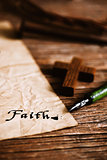 wooden christian cross and word faith