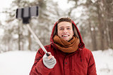 happy man taking selfie by smartphone in winter