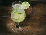 cocktail with lime, lemon, gin and ice cubes