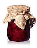 Currant jam in jar with burlap