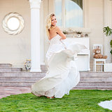 Gorgeous bride in wedding dress outdoors