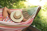Man Sleeping Relaxing With hat on face In Hammock