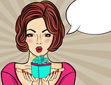 Surprised pop art  woman that holds a gift in their hands . Comi