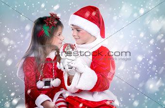 boy and girl as santa and elf