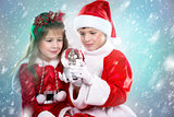 boy and girl as santa and elf