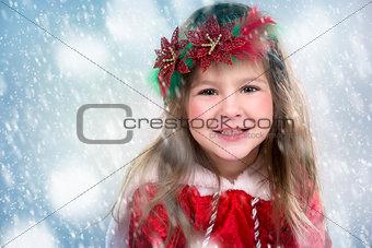 little girl as santa and elf