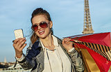 fashion-monger taking selfie with smartphone in Paris, France