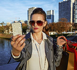 trendy woman with shopping bags taking selfie with phone, Paris