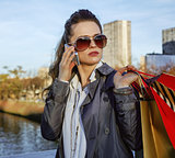 fashion-monger with shopping bags talking on smartphone in Paris
