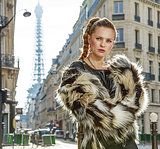 modern fashion-monger in Paris, France looking into distance