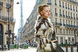 relaxed trendy woman in fur coat in Paris, France
