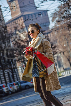 modern tourist woman with shopping bags in Milan, Italy walking