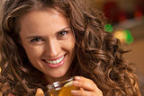 happy young woman with cup of ginger tea