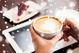 close up of hands with coffee, tablet pc and cake