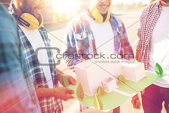 close up of builders with paper house model