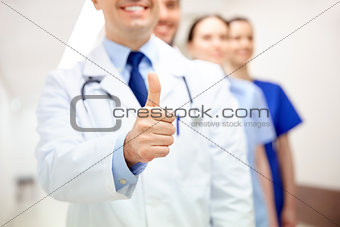 close up of doctors at hospital showing thumbs