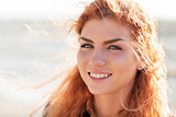 close up of happy young redhead woman face