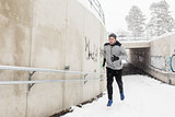 man running out of subway tunnel in winter