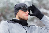 close up of sports man with ski goggles in winter