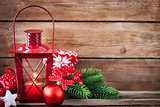 Christmas time red latern with candle light and holiday decorati