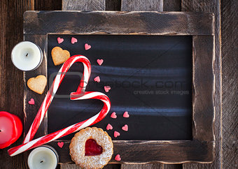Chalk board and heart shaped candies and cookies