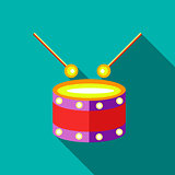 Children's toy drum on blue-green background