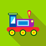 Children's toy train on a bright green background