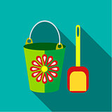 Children's toy pail with shovel in blue-green background