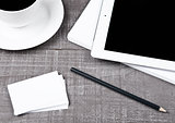 Graphic tablet with pencil paper cards and coffee