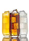 Glasses with cola orange soda and lemonade ice