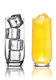 Glass of orange soda with ice cubes empty glass