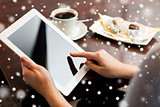close up of woman with tablet pc and coffee
