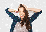 happy smiling pretty teenage girl over snow