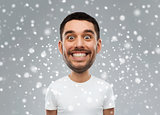 man with funny face over snow background