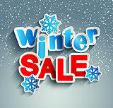 Winter sale inscription with snowflakes.