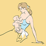 Beautiful mother breastfeeds the baby