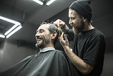 Cutting hair in barbershop