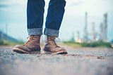 Smart Man Engineer Wear Jeans And Brown Boots for Worker Security on Background of Refinery