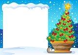 Snowy frame and Christmas tree on sledge