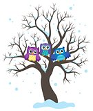 Stylized owls on tree theme image 1
