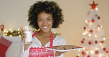 Happy young woman with milk and cookies for Santa