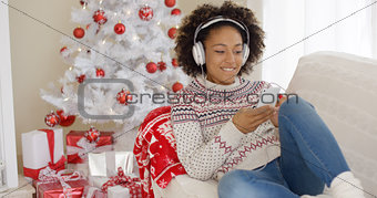Attractive woman listening to music at Christmas